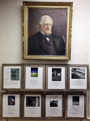 A number of framed poems and photography rests underneath a portrait of Clift Rodgers from 1897.   Wicked Local Staff Photo/ Robin Chan